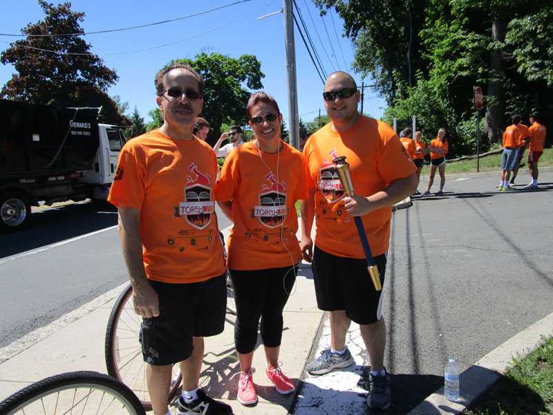 Dr. Carniol participated in the annual Torch Run with the Police which raises money for the Special Olympics in New Jersey. Pictured left to right - Dr. Carniol, Lieutenant Justine Kennedy and Officer David Rodriguez Friday, June 10.